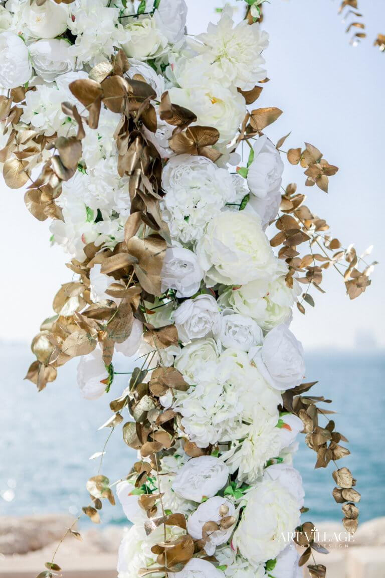 white flowers with golden leaves